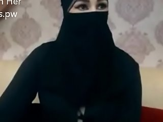 Indian Muslim girl in hijab dwell chatting beyond webcam
