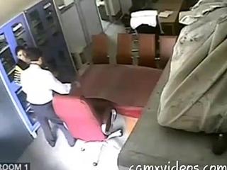 A indian school omnibus banging a fellow teacher.