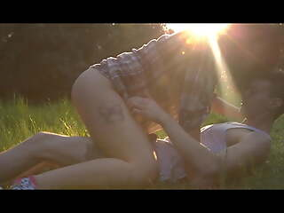Young sexy couple goes wild in nature