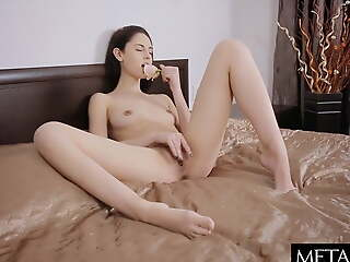 Beauty tugs her nipples and stuffs fingers in her pussy