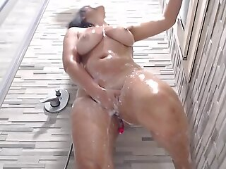sexy girl with obese tits masturbates in the shower