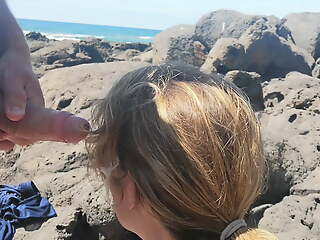 Exciting blowjob in public with forefathers on the beach
