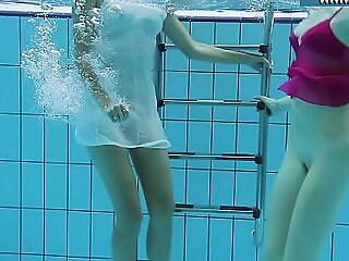 Fervently dressed teens in the pool
