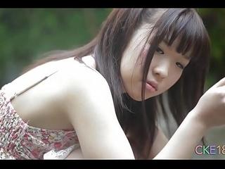 Shy Japanese teen benefactor prankish grow older erotic outdoor tease